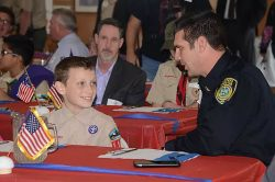 Madera Police Officer Gino Chiaramonte is partnered with Boy Scout Paul Lasgoity of Troop116 during the annual Boy Scout Civics Day luncheon on Wednesday.